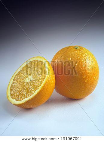 Cross-section of orange by whole orange
