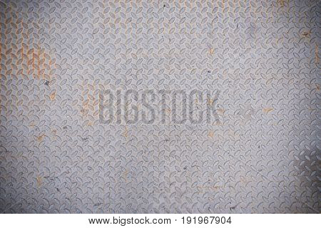 Weathered silver colour diamond plate background and texture.