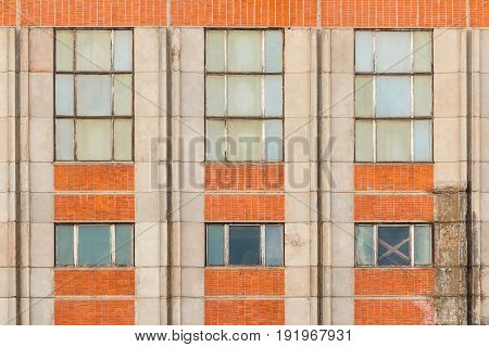 Several windows in row on facade of industrial building front view St. Petersburg Russia