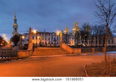 Krasnogvardeyskiy bridge and St. Nicholas Naval Cathedral illuminated at night HDR St. Petersburg Russia