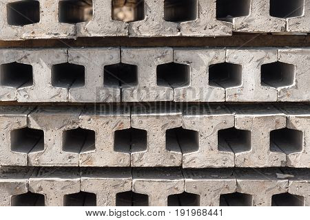 Prestressed I concrete piles used for construction job.