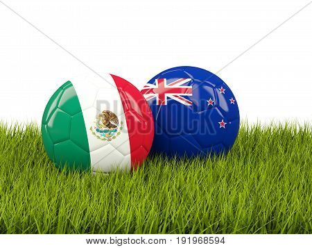 Two Footballs With Flags Of Mexico And New Zealand On Green Grass