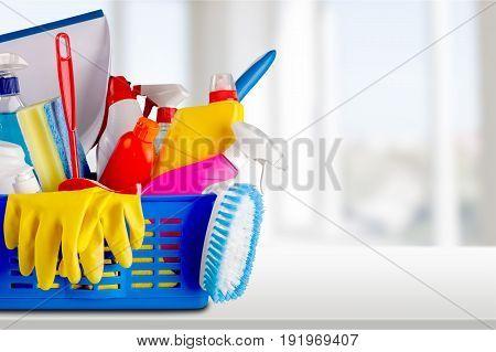 Plastic gloves clean bottles sponges green yellow