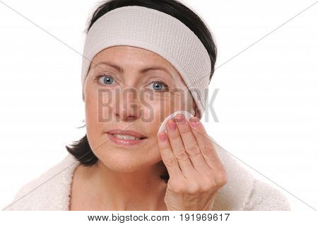 portrait of pretty senior woman with hands on her face, beauty and care concept