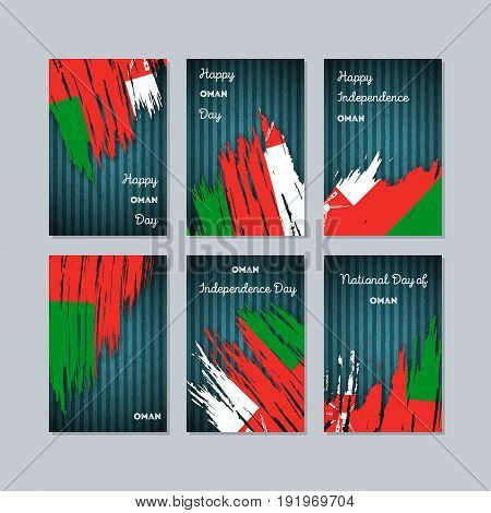 Oman Patriotic Cards For National Day. Expressive Brush Stroke In National Flag Colors On Dark Strip