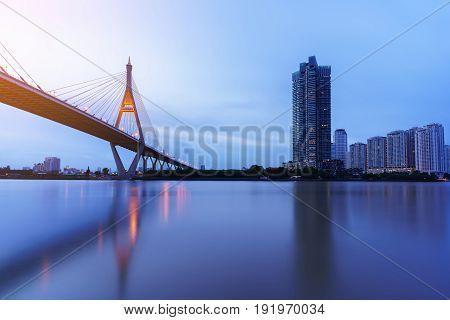 Bhumibol bridge so called Industrial Ring Bridge crossing The Chao Phraya River with reflection Bangkok Thailand
