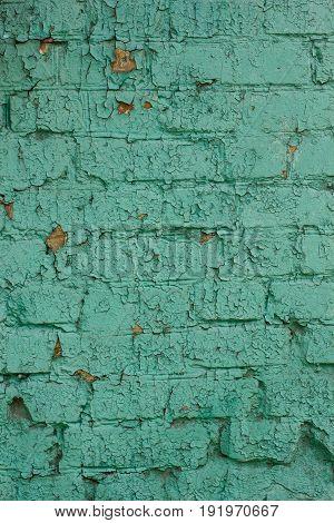 old brick wall with blue peeling paint bricks background. vintage brick wall texture