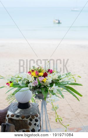 loral arrangements and decoration. Arrangement of pink and white flowers in restaurant for luxury wedding even
