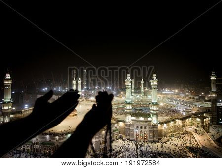 Muslim hands praying in Kaaba