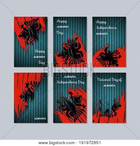 Albania Patriotic Cards For National Day. Expressive Brush Stroke In National Flag Colors On Dark St