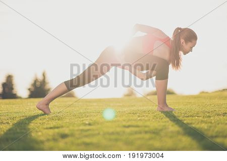 Stretching On Fresh Air. Wellbeing, Wellness, Vitality, Peace Lifestyle. Young Sporty Woman Is Pract