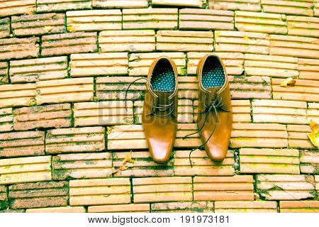 Business Man Brown Shoes Top View on brick background