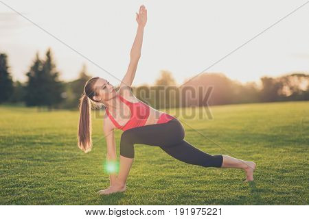 Young Sport Woman Trainer Is Making Stretching Outdoors In Spring Park, So Relaxed And Healthy, Wear