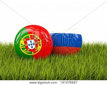 Two Footballs With Flags Of Portugal And Russia On Green Grass