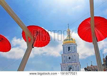 KYIV, UKRAINE - MAY 01, 2017: Bright red umbrellas decoration in fan zone for international song competition Eurovision-2017 on Sofia square in Kyiv.