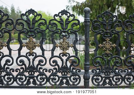 Beautiful wrought fence. Image of a decorative cast iron fence. metal fence close up. beautiful fence with artistic forging