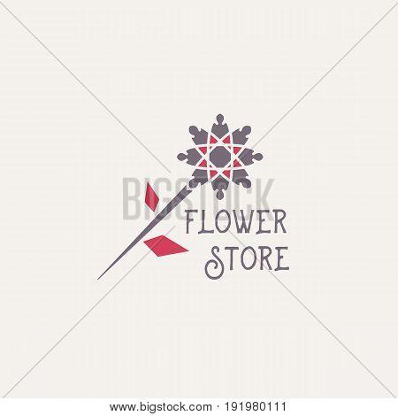 Flower store symbol or emblem. Vector geometric logo template for flower shop