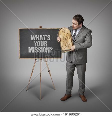 What s your mission text on blackboard with businessman and abacus