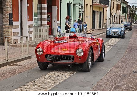 GATTEO, FC, ITALY - MAY 19: driver and co-driver on a rare racing car Ferrari 500 Mondial (1954) in historical classic car race Mille Miglia, on May 19, 2017 in Gatteo, FC, Italy