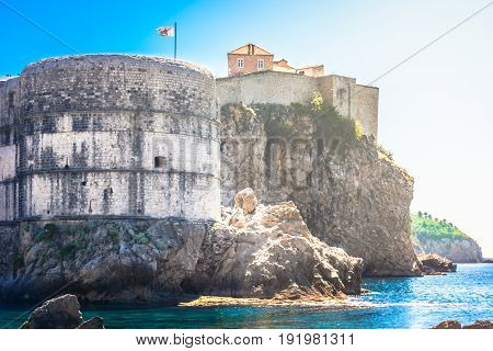 Waterfront view at historic fort and city walls in famous european travel destination, Dubrovnik town.