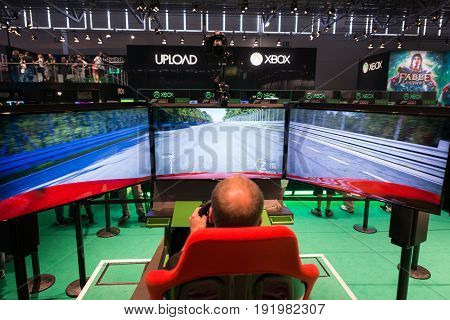 Cologne, Germany, August 13, 2014: Xbox one and forza on gamescon. Gamescom is a trade fair for video games held annually at the Koelnmesse in Cologne.