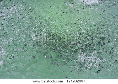 Detail of a water surface of a fountain pool