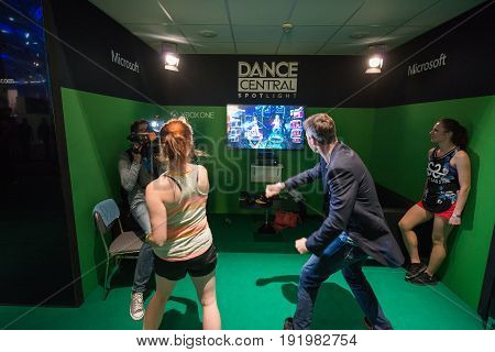 Cologne, Germany, August 13, 2014: Microsoft xbox one and dance central spotlight on gamescon. Gamescom is a trade fair for video games held annually at the Koelnmesse in Cologne.