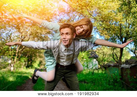 Portrait Of Happy Couple Raising Their Hands In Open Air