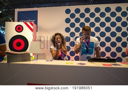 Cologne, Germany, August 13, 2014: Singstar presentation on gamescon.  Gamescom is a trade fair for video games held annually at the Koelnmesse in Cologne.