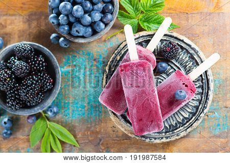 Fresh Summer Wild Blueberries And  Brambleberry, Home Made Sorbet Ice Cream Popsicles On Stone Plate