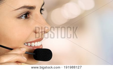 Young woman headphones global network background view close-up