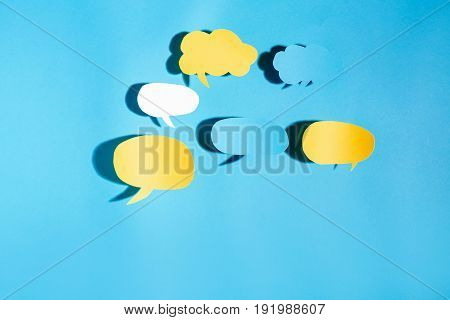 Speech bubble text message theme with hard shadow on a blue background