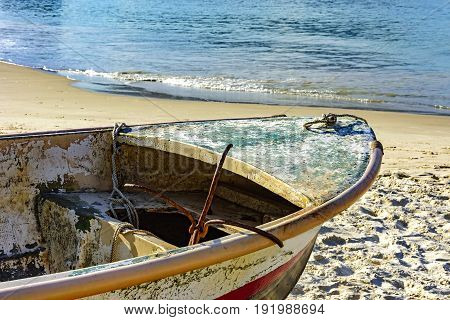 Old fishing boat on the sand of Copacabana beach in Rio de Janeiro