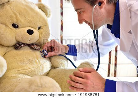 Pediatrician Doctor Auscultating Teddy Close Up