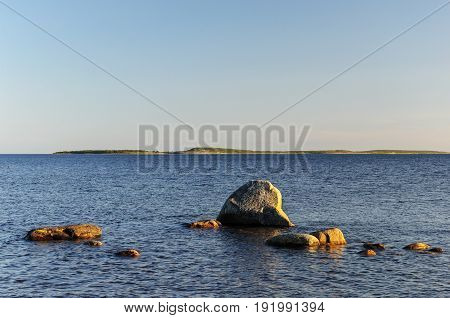 Large stones in the White Sea Bolshoy Solovetsky Island Russia. Sunny summer evening.