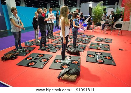 Cologne, Germany, August 13, 2014: Retro dance mat games on gamescon. Gamescom is a trade fair for video games held annually at the Koelnmesse in Cologne.