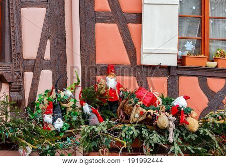 Traditional old half-timbered houses in the historic part of the city decorated with Christmas toys. Alsace. France. Colmar.