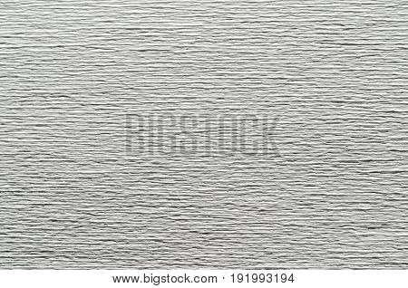 White texture of embossed paper. Abstract background with deep grooves in the texture of corrugated paper. Pattern of horizontal grooves