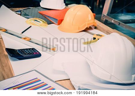 Architects who work with blueprints inspecting workplace engineers for architectural planning drafting construction projects