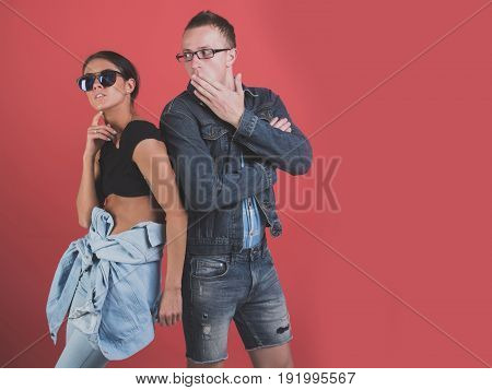 Portrait Of Modern Young People Wearing Jeans Clothes And Sunglasses