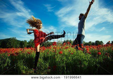 Couple Dancing In Red Poppy Field