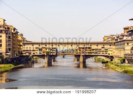 Medieval stone bridge Ponte Vecchio over the Arno River in Florence Tuscany Italy. Florence is a popular tourist destination of Europe