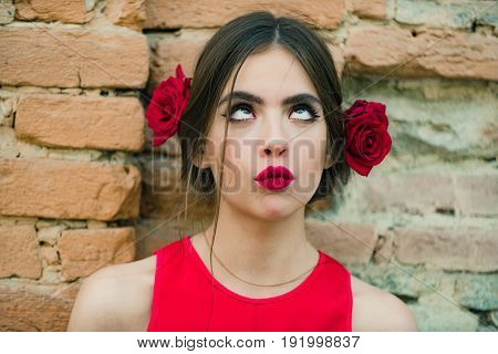 Curious Woman With Red Lips And Fresh Roses In Hair