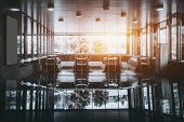 Contemporary empty chrome and glass subway hall with several escalators and panoramic windows with strong reflection and frontal warm flare on sunny day poster