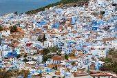 Panorama of Chefchaouen Blue Medina at sunset in Morocco, North Africa poster