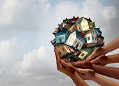 Social housing concept and supportive home ownership symbol as a group of diverse hands holding many family homes as a metaphor for supporting neighborhood togetherness. poster