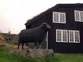 Statue of a Black Ram is symbolic of one of the two main industries of Torshavn Faroe Islands poster