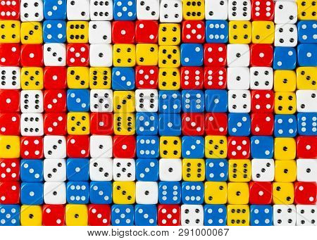 Pattern Background Of Random Ordered Red, White, Yellow And Blue Dices