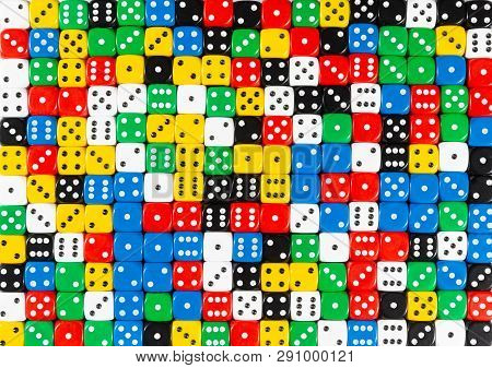 Pattern Background Of Random Ordered Black, White, Red, Yellow, Blue And Green Dices