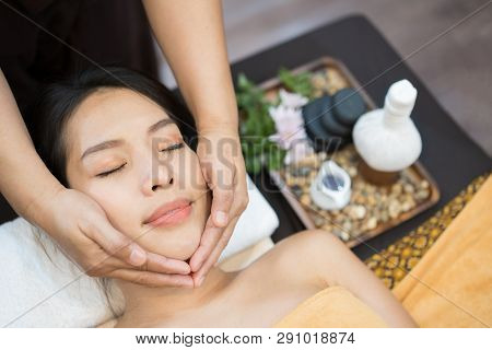 Face Massage. Close-up Of Young Woman Getting Spa Massage Treatment At Beauty Spa Salon. Spa Skin An